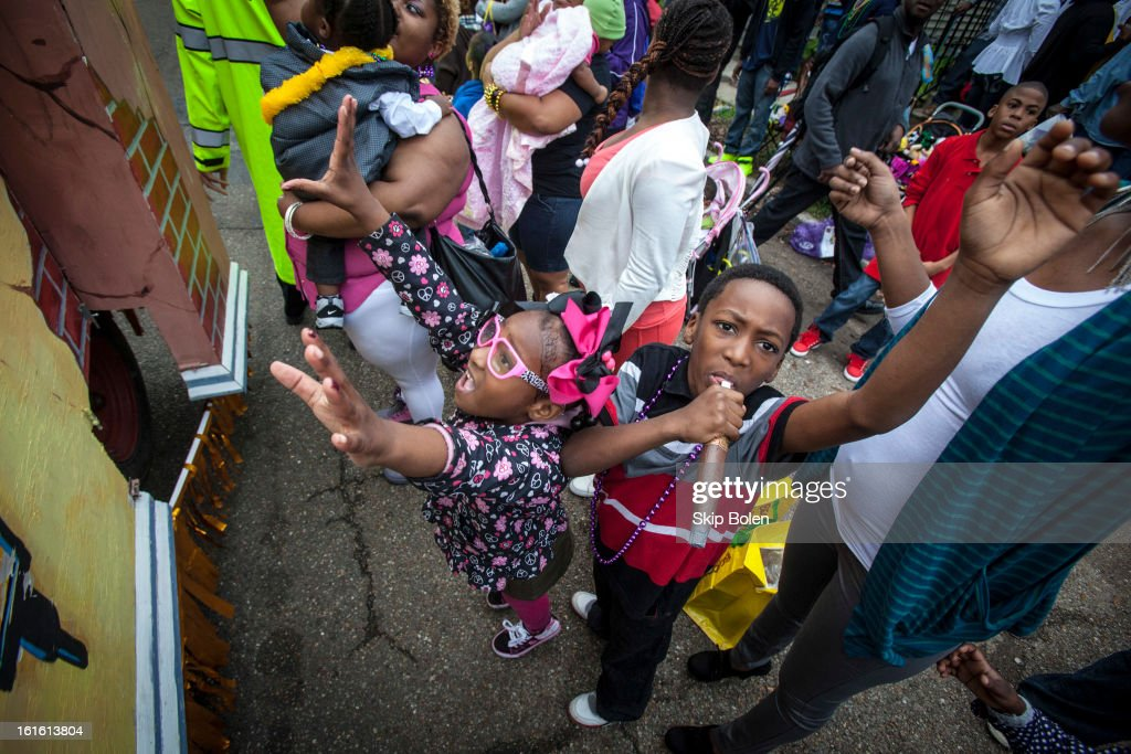 Young fans and parade-watchers hoping to catch beads and trinkets in the 'Zulu Parade' on Jackson Avenue, the first parade on the morning of Mardi Gras on February 12, 2013 in New Orleans, Louisiana.