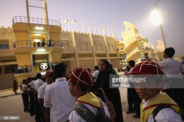 Young fans arrive at Al Gharafa Stadium to watch the Gharafa vs Kharaitiyat Qatar Stars League football match on October 23 2011 in Doha Qatar Qatar...