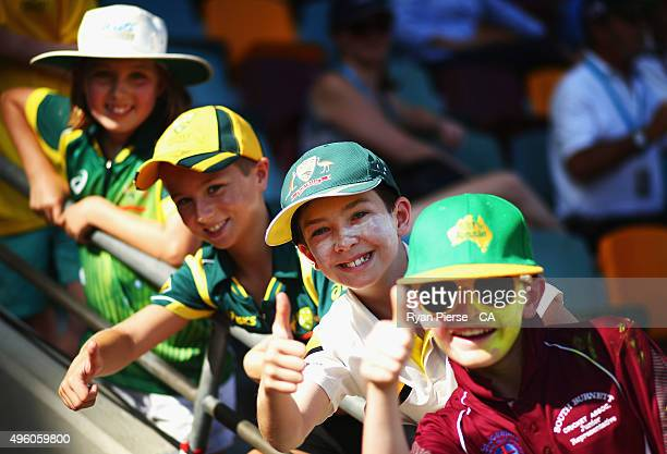 Young fans cheer during day three of the First Test match between Australia and New Zealand at The Gabba on November 7 2015 in Brisbane Australia
