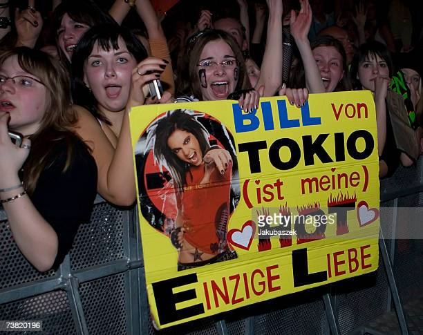 Young fans cheer while the German teen band Tokio Hotel performs during their ''Zimmer 483'' concert at the Torwar Hall April 5 2007 in Warsaw Poland...
