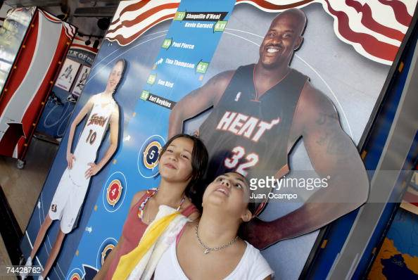 Young fans compare their height to a full size likeness of Shaquille O'Neal of the Miami Heat at the NBA Jam Van on June 6 2007 at Universal City...