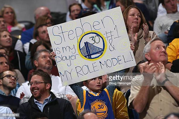 A young fans displays a sign in support of Stephen Curry of the Golden State Warriors as he faces the Denver Nuggets at Pepsi Center on January 13...