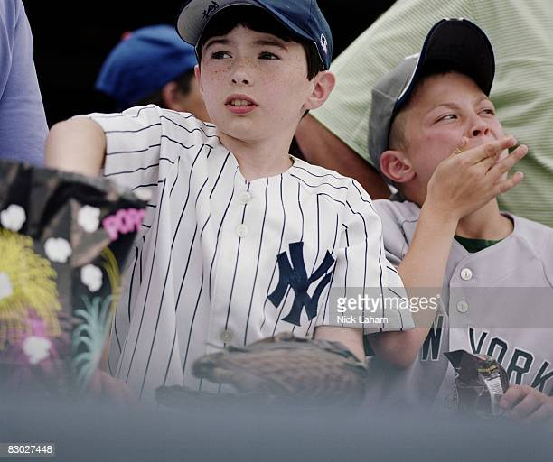 Young fans eat popcorn at Yankee Stadium on May 8 2008 in the Bronx borough of New York City The Yankees are playing their final season in the 85...