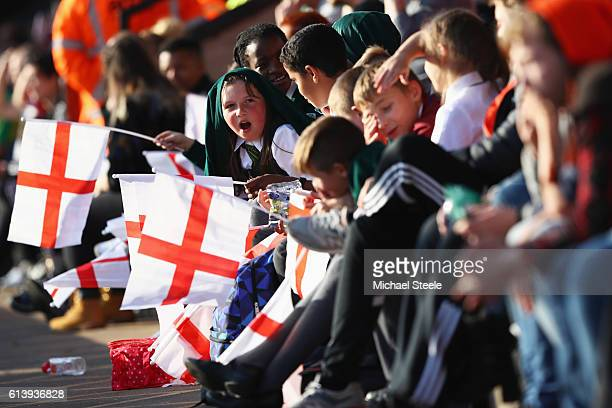 Young fans enjoy the atmosphere during the UEFA European U21 Championship Group 9 qualifying match between England and Bosnia and Herzegovina at...