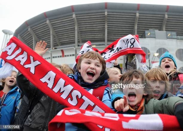 Young fans gather before the Dutch football cup match between Ajax Amsterdam and AZ from Alkmaar in Amsterdam on January 19 2012 After a spectator...
