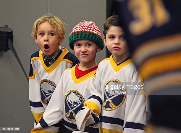 Young fans greet the Buffalo Sabres as they make their way to the ice to play the Anaheim Ducks in an NHL game on December 17 2015 at the First...