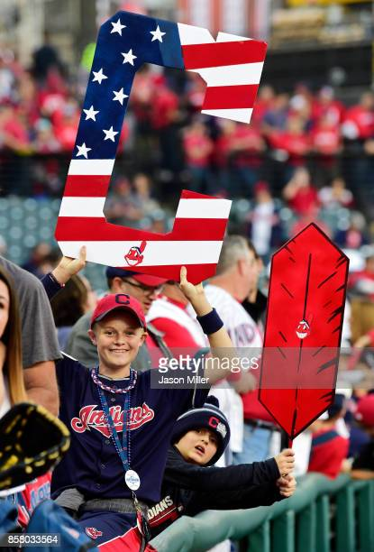 Young fans hold signs supporting the Cleveland Indians during batting practice prior to game one of the American League Division Series against the...
