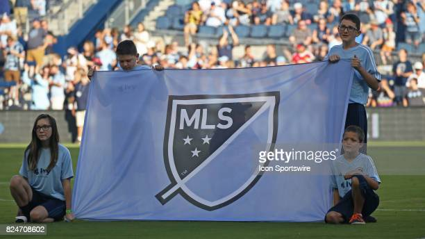 Young fans hold the MLS banner up before an MLS match between the Chicago Fire and Sporting KC on July 29 2017 at Children's Mercy Park in Kansas...