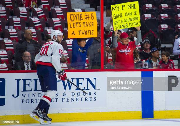Young fans hold up banners during the pregame warmup before the NHL game between the Ottawa Senators and the Washington Capitals on Oct 5 2017 at the...