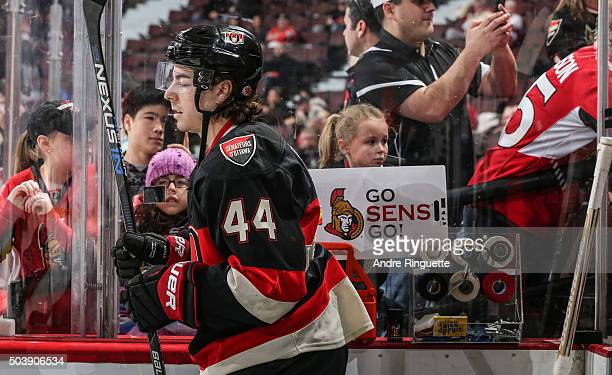 A young fans holds a sign saying 'Go Sens Go' as JeanGabriel Pageau of the Ottawa Senators walks out to the ice for warm up prior to a game against...