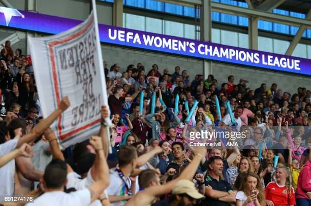 Young fans join in with the PSG Ultras as they sing and chant during the UEFA Women's Champions League Final match between Lyon and Paris Saint...