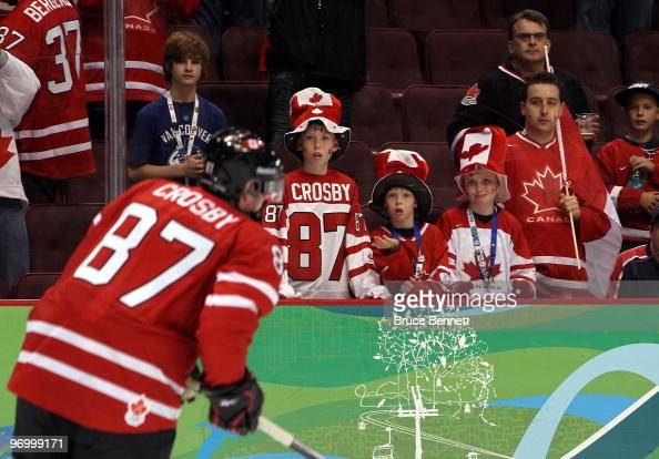 Young fans look on as Sidney Crosby of Canada warms up during the ice hockey Men's Qualification Playoff game between Germany and Canada on day 12 of...