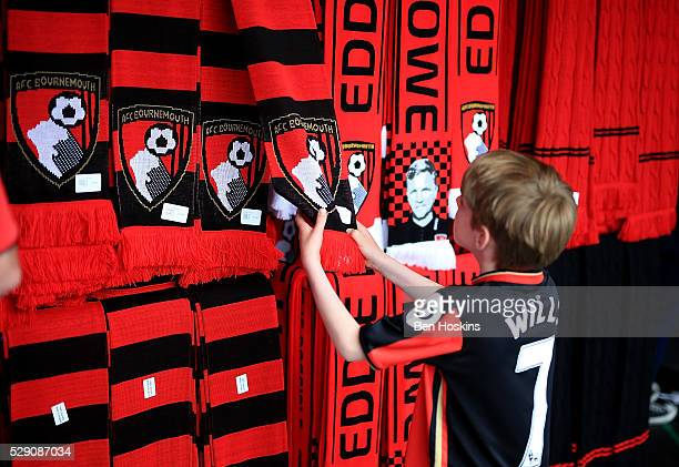 A young fans looks at merchandise in the club shop during the Barclays Premier League match between AFC Bournemouth and West Bromwich Albion at the...