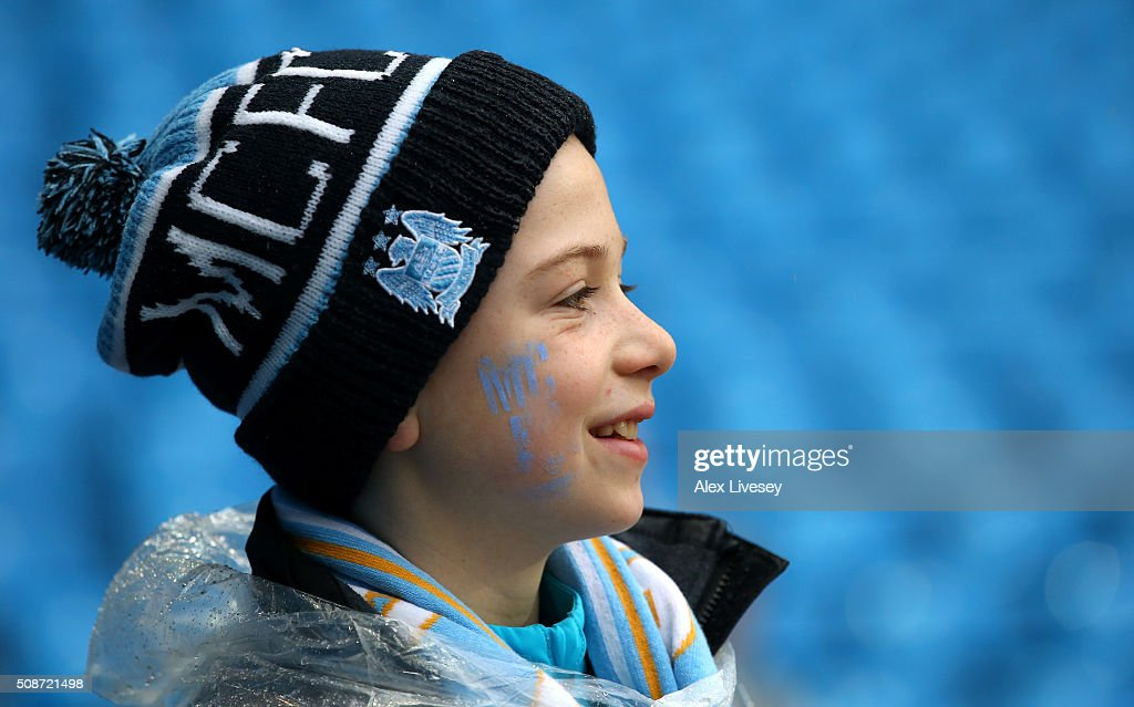 A young fans looks on prior to the Barclays Premier League match between Manchester City and Leicester City at the Etihad Stadium on February 6, 2016 in Manchester, England.