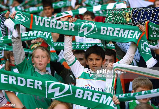 Young fans of Bremen shows their scarves during the Bundesliga match between Werder Bremen and 1899 Hoffenheim at the Weser stadium on September 27...