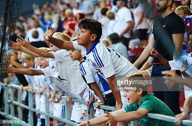 Young fans of FC Copenhagen cheer during halftime in the Danish Alka Superliga match between FC Copenhagen and OB Odense at Telia Parken Stadium on...