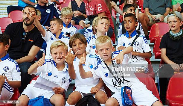 Young fans of FC Copenhagen cheer prior to the Danish Alka Superliga match between FC Copenhagen and OB Odense at Telia Parken Stadium on September...