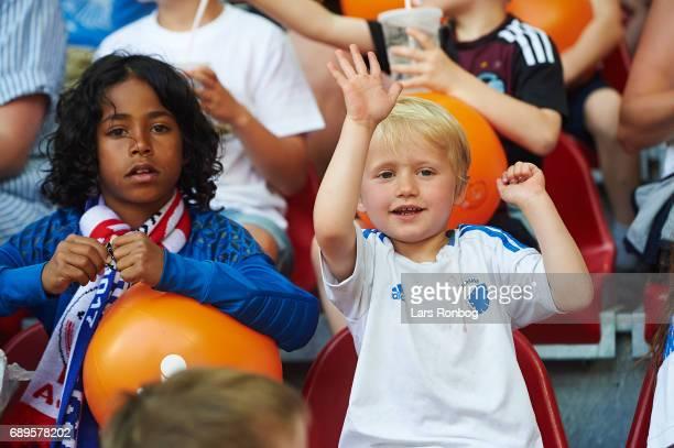 Young fans of FC Copenhagen cheer prior to the Danish Alka Superliga match between FC Copenhagen and Sonderjyske at Telia Parken Stadium on May 28...