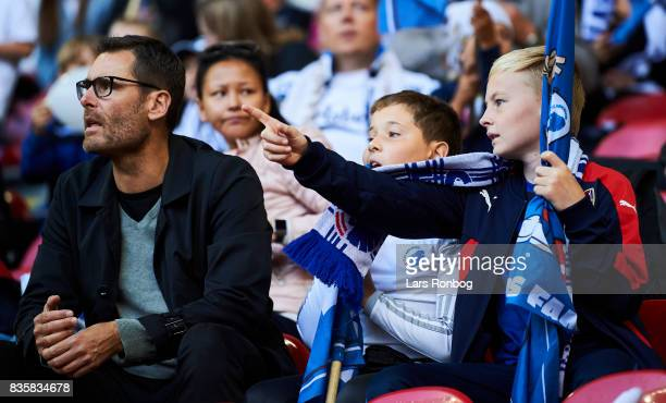 Young fans of FC Copenhagen cheer prior to the Danish Alka Superliga match between FC Copenhagen and Sonderjyske at Telia Parken Stadium on August 19...