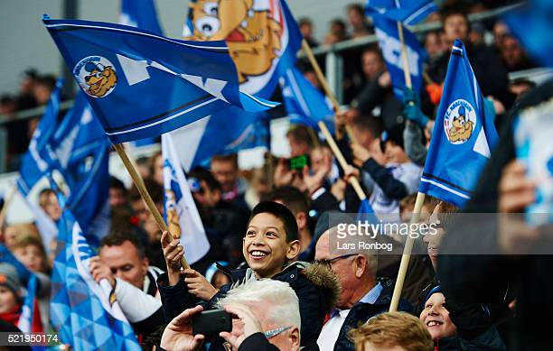 Young fans of FC Copenhagen with flags prior to the Danish Alka Superliga match between FC Copenhagen and Brondby IF at Telia Parken Stadium on April...