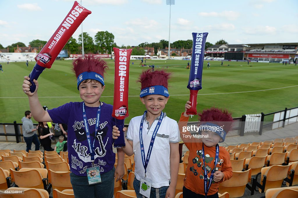 Young fans of Northamptonshirepose with their inflatable bats during the NatWest T20 Blast match between Northamptonshire and Derbyshire at The County Ground on May 27, 2016 in Northampton, England.