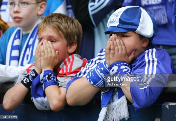 Young fans of Schalke gesture during the Bundesliga match between Schalke 04 and Arminia Bielefeld at the Veltins Arena on May 19 2007 in...