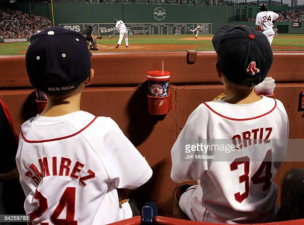 Young fans of the Boston Red Sox watch as David Ortiz bats and Manny Ramirez waits on deck during the first inning against the Baltimore Orioles at...