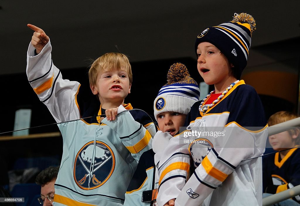 Young fans of the Buffalo Sabres watch them warm up for their game against the Calgary Flames on December 14, 2013 at the First Niagara Center in Buffalo, New York.
