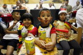 Young fans of the German national football team drink icetea as they watch the FIFA World Cup semifinal match Germany vs Spain in an Arabic cafe in...