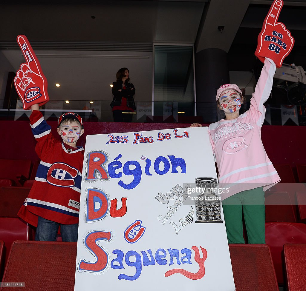 Young fans of the Montreal Canadiens from Saguenay support their team before the game against the New York Rangers during the NHL game on April 12, 2014 at the Bell Centre in Montreal, Quebec, Canada.