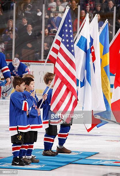 Young fans of the Rangers hold flags representing countries for each of the New York Ranger players who will participate in the Winter Olympics in...