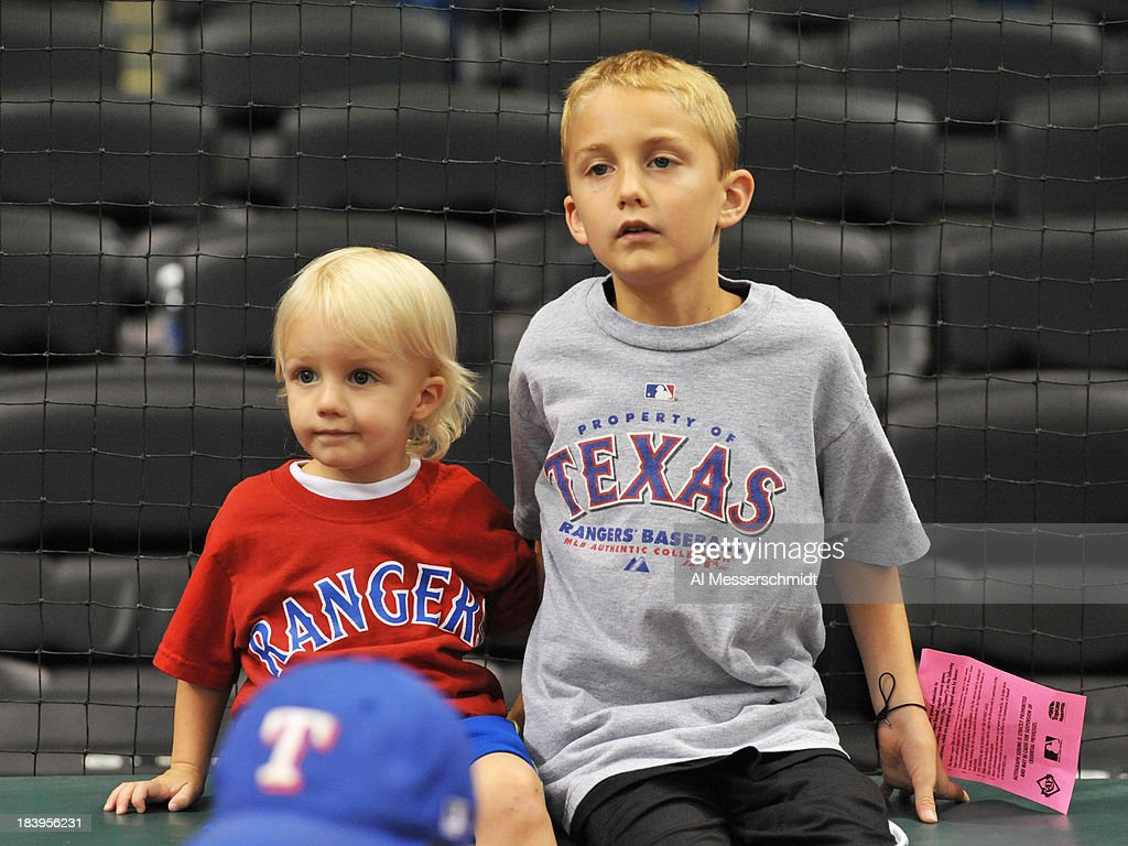 Young fans of the Texas Rangers watch batting practice before play against the Tampa Bay Rays September 18, 2013 at Tropicana Field in St. Petersburg, Florida.