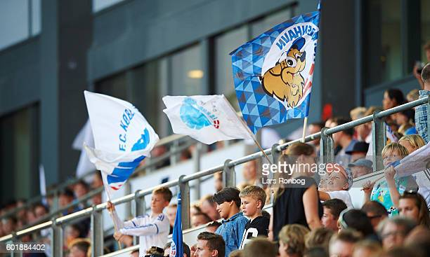 Young fans on the Family stand cheer with flags prior to the Danish Alka Superliga match between FC Copenhagen and OB Odense at Telia Parken Stadium...
