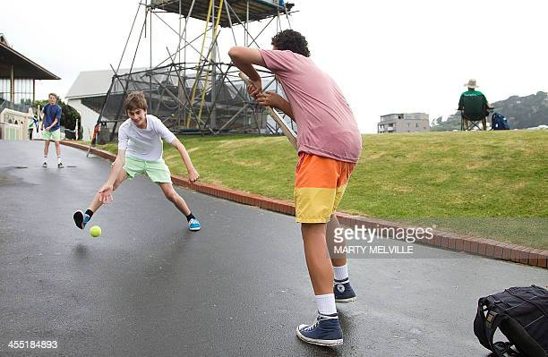 Young fans play cricket during a rain delay on day two of the second international cricket Test match between New Zealand and the West Indies at the...