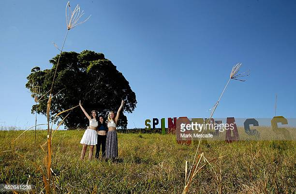 Young fans pose in front of a festival sign at Splendour In the Grass 2014 on July 25 2014 in Byron Bay Australia