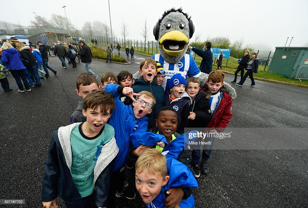 Young fans pose with Sammy the Brighton mascot prior to kickoff during the Sky Bet Championship match between Brighton and Hove Albion and Derby County at the Amex Stadium on May 2, 2016 in Brighton, United Kingdom.