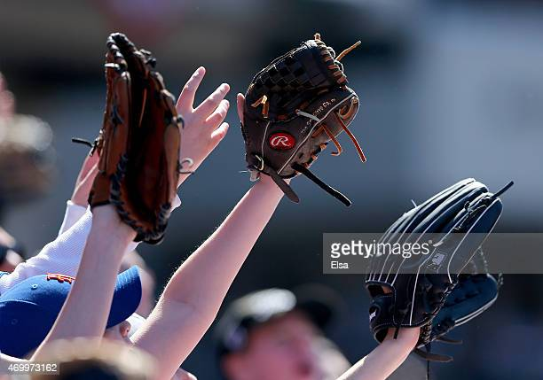 Young fans reach for a baseball in between innings between the New York Mets and the Philadelphia Phillies during Opening Day on April 13 2015 at...