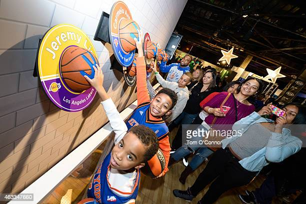 Young fans seeing how their hands measure up against some of the NBA All Stars hand sizes at NBA House at Moynihan Station during the 2015 NBA...