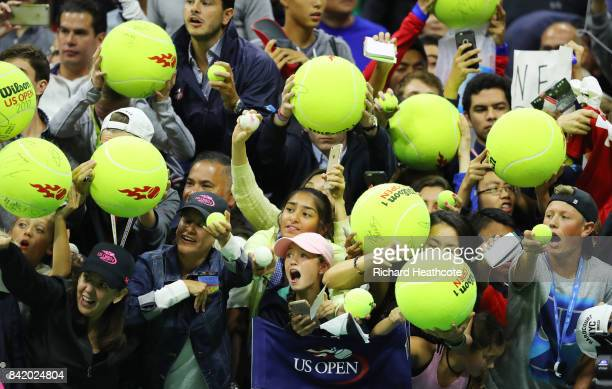 Young fans seek autographs from Roger Federer of Switzerland after he defeated Feliciano Lopez of Spain during their third round Men's Singles match...