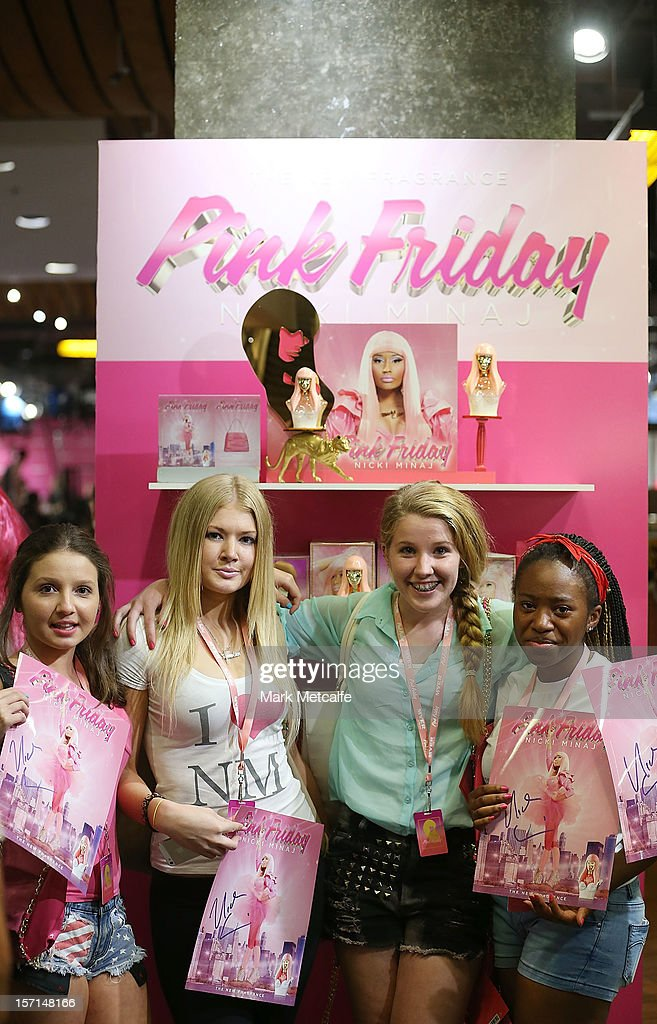 Young fans show their autographed items after meeting Nicky Minaj during an event to celebrate the launch of her new perfume at Myer Sydney City on November 29, 2012 in Sydney, Australia.