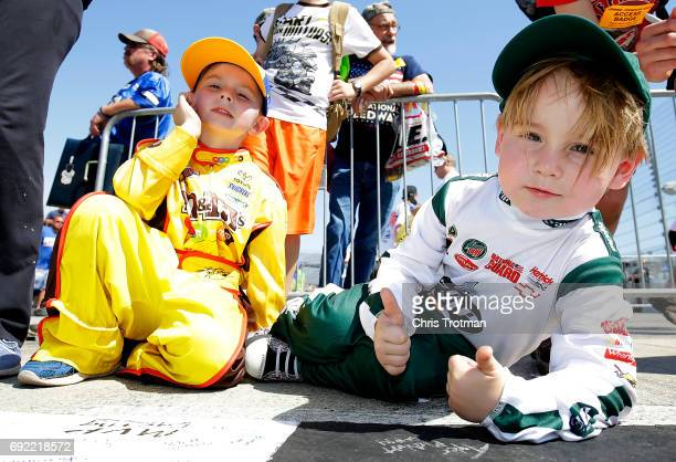 Young fans sign the start finish line prior to the Monster Energy NASCAR Cup Series AAA 400 Drive for Autism at Dover International Speedway on June...