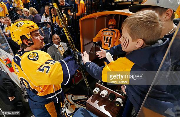 Young fans tap the glove of Roman Josi of the Nashville Predators after warmups prior to an NHL game against the St Louis Blues at Bridgestone Arena...