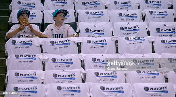 Young fans wait for the start of Game Three of the Eastern Conference Quarterfinals beyween the Miami Heat and the Charlotte Bobcats during the 2014...