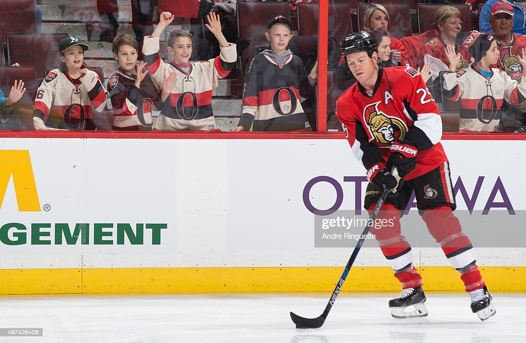 Young fans watch Chris Neil of the Ottawa Senators warm up prior to a game against the Detroit Red Wings at Canadian Tire Centre on November 16 2015...