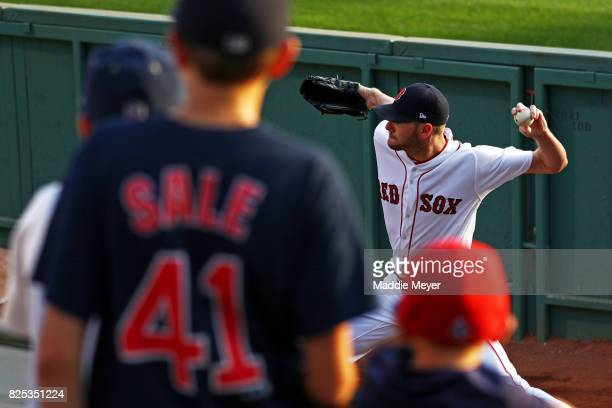 Young fans watch Chris Sale of the Boston Red Sox warm up in the bullpen before the game between the Red Sox and the Cleveland Indians at Fenway Park...
