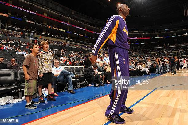 Young fans watch Kobe Bryant of the Los Angeles Lakers warm up prior to the game against the Los Angeles Clippers at Staples Center on October 29...