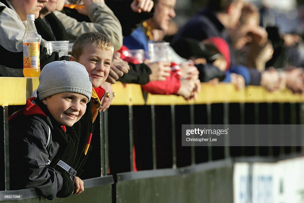 Young fans watch the match as their put their heads through the barriers during the Powergen Cup Third Round match between Newport Gwent Dragons and...