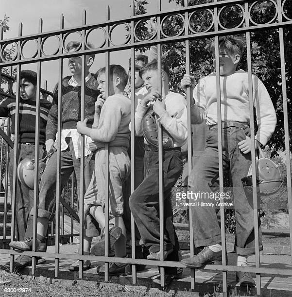 Young Fans Watching High School Football Game Through Fence Washington DC USA Esther Bubley for Office of War Information October 1943