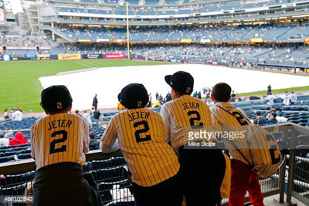 Young fans wearing Derek Jeter jerseys look on from the concourse of Yankee Stadium prior to his last game there on September 25 2014 the Bronx...