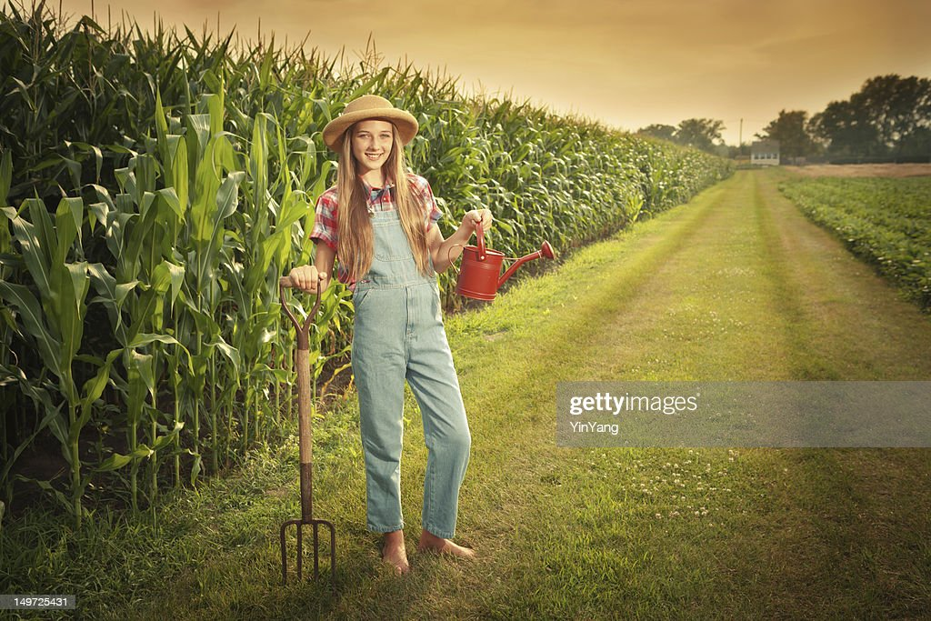 http://media.gettyimages.com/photos/young-farmer-girl-holding-gardening-tools-by-the-field-hz-picture-id149725431